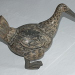 The coconut shell duck fully repaired and touched up
