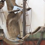 Yard arms broken and sails damaged by use of steel wire